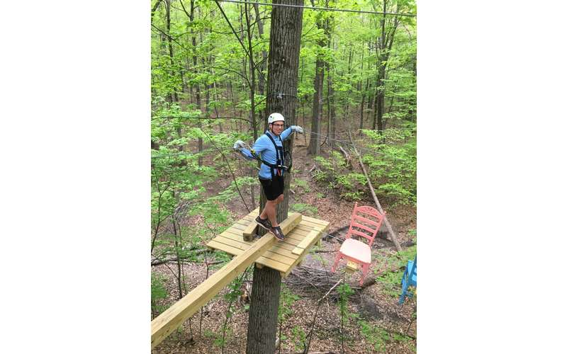 Zip lining is not as physically challenging as the Treetop Challenge Course.