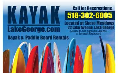 row of colorful paddleboards with text that says kayaklakegeorge.com and call for reservations 518-302-6005