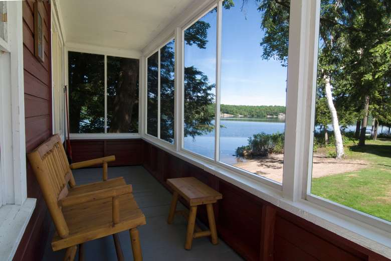 screened in porch of cabin number 6 overlooking long lake
