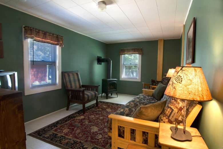 living room of cabin number 4 with corner woodstove