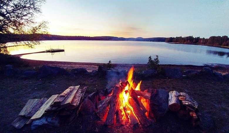 bonfire on the beach at sunset