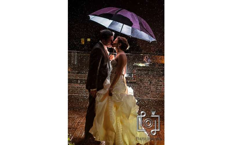 Enjoying the Wedding Rain