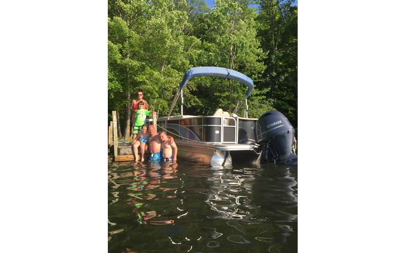 A pontoon ride is a great way to spend the day with the family on the lake.
