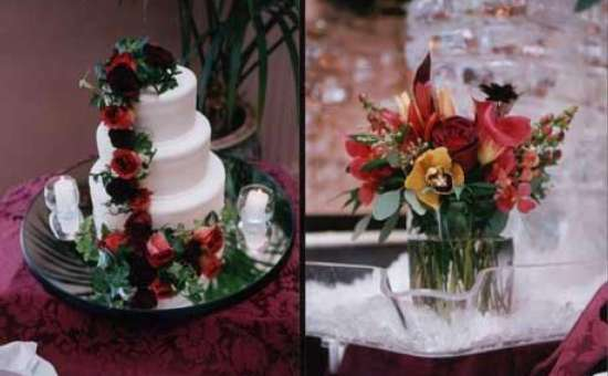 three tiered cake with flowers on it and a small vase of flowers