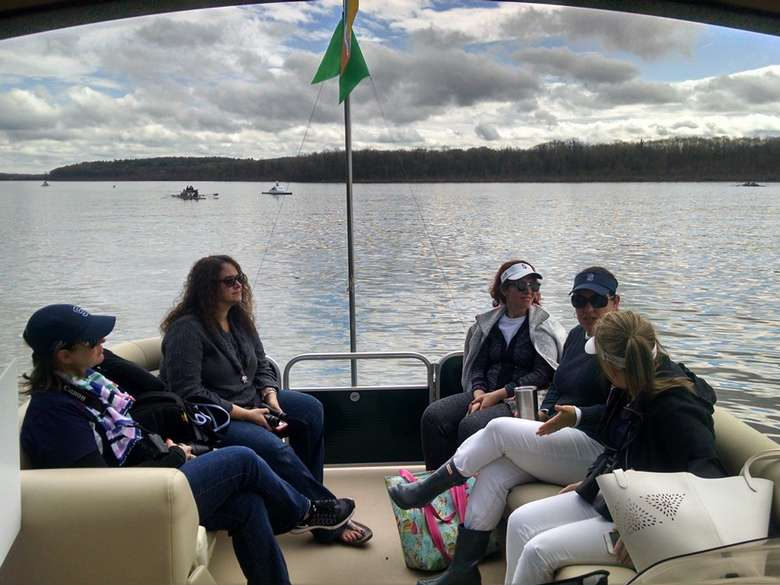 guests on board a pontoon boat sitting on luxury seats while cruising