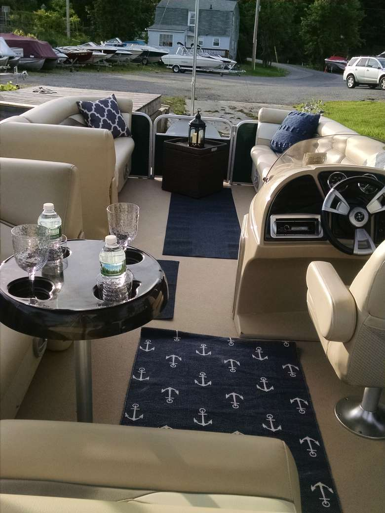 luxury seating and tables on a pontoon boat
