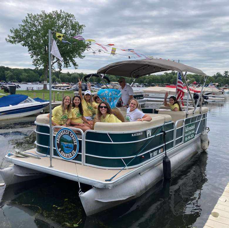 people in a pontoon boat