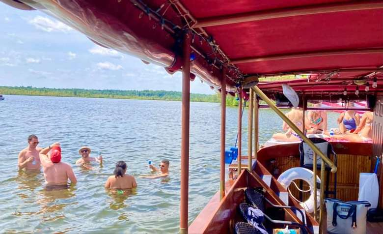 view of people swimming by a boat