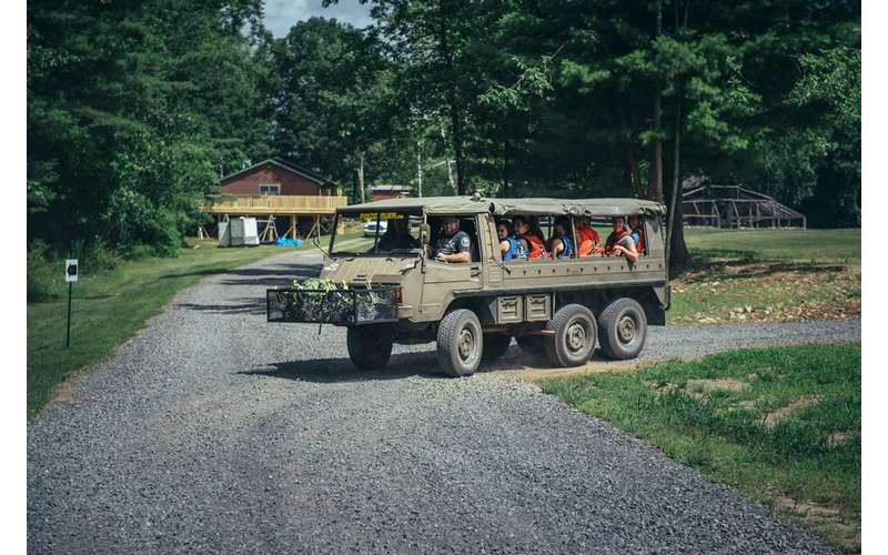 an off road vehicle with people