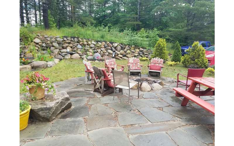 fire pit, chairs and landscaping
