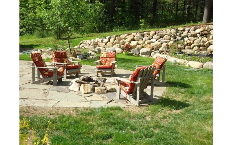 fire pit with chairs on patio area
