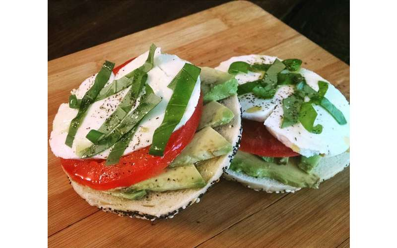 Avocado caprese on everything bagel