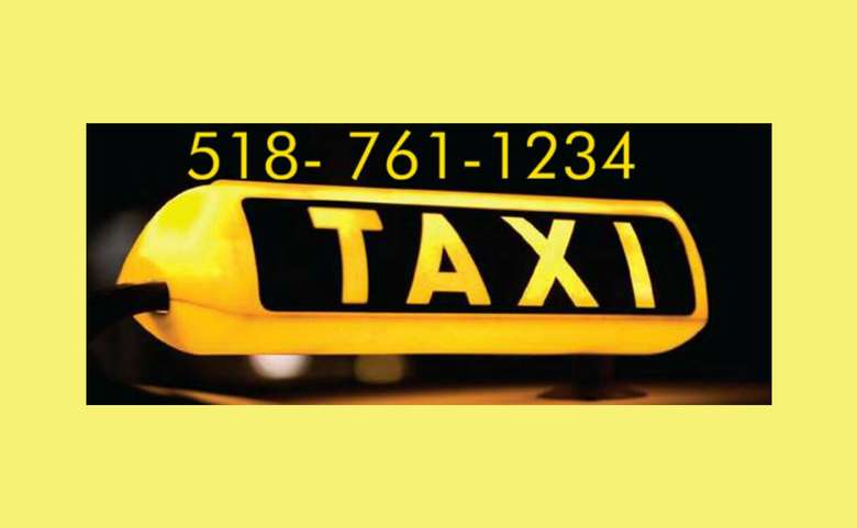 a taxi logo with a phone number directly above it