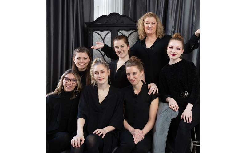 group of women wearing black
