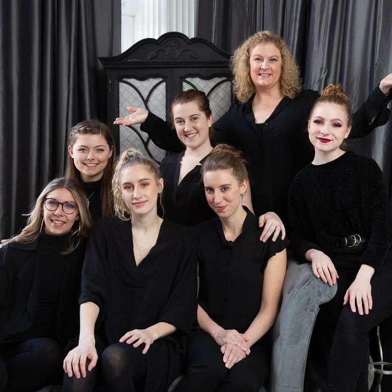 group of women wearing black