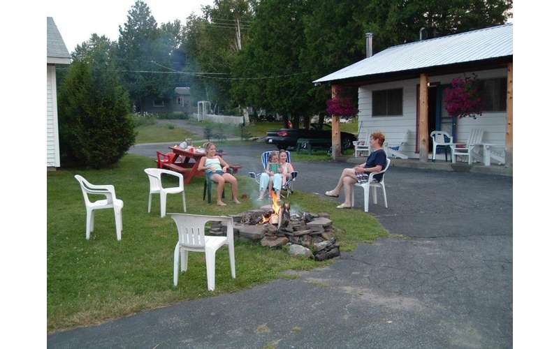 people enjoying a campfire outside the cabin
