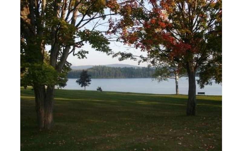 lake with trees with fall foliage