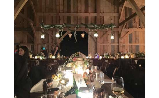long table inside a wedding reception venue at night