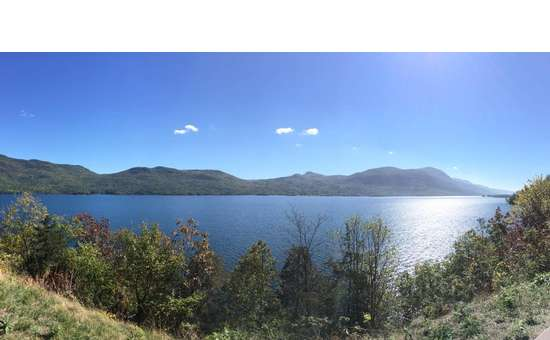 panoramic shot of a lake on a sunny day