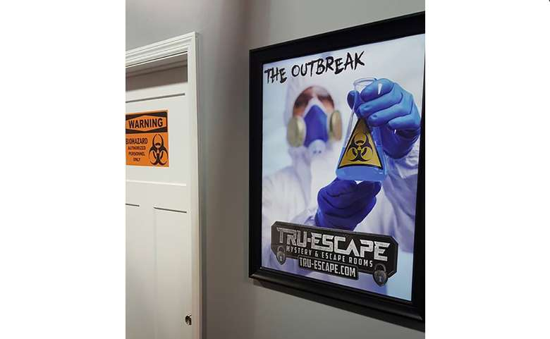 a poster on a wall showcasing an escape room