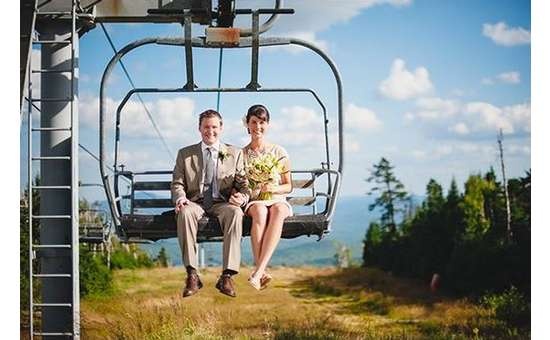 Bride & Groom riding one of our chair lifts