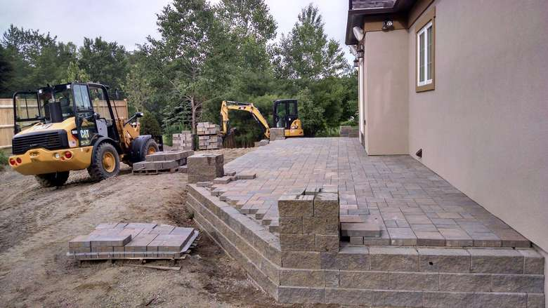 landscaping experts constructing a patio