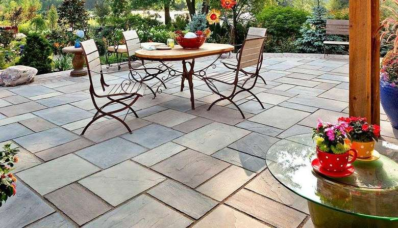 patio made from slate pavers with a table and chairs