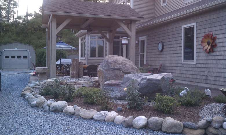 exterior of a home with new landscaping and stonework