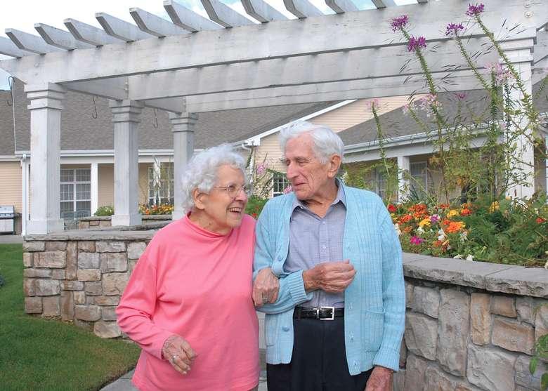 an elderly couple taking a walk outside