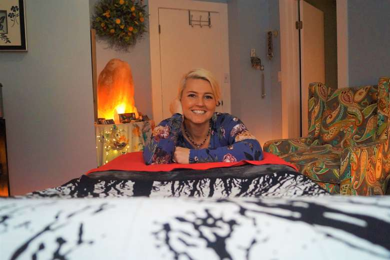 june stoddard-finemore smiling in her treatment room