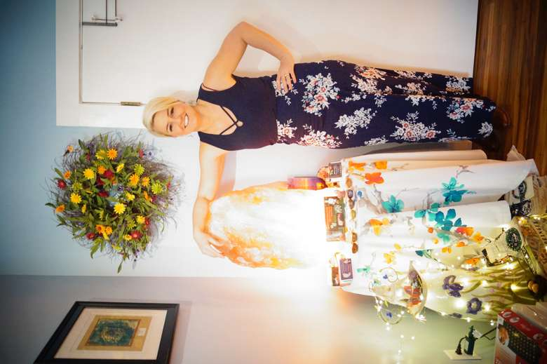 june stoddard-finemore posing with a large himalayan salt stone