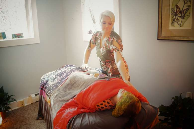 june stoddard-finemore performing reiki on a client