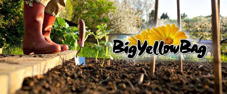 big yellow bag logo on top of a garden picture