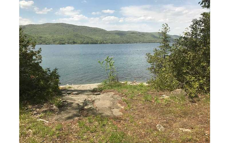 A rocky ledge overlooking Lake George at Campsite #1