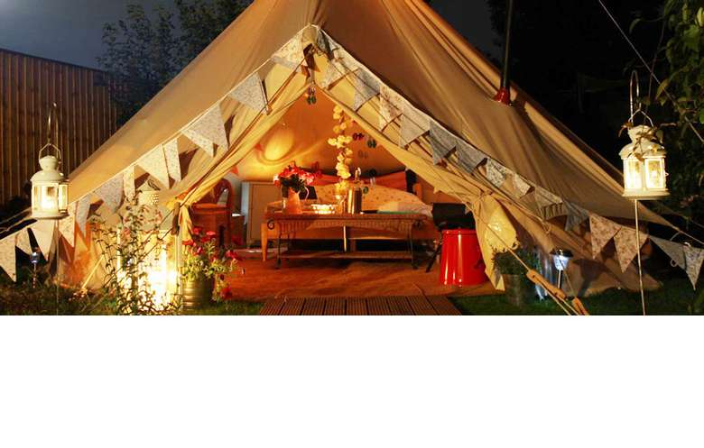luxury tent with a king-sized bed inside