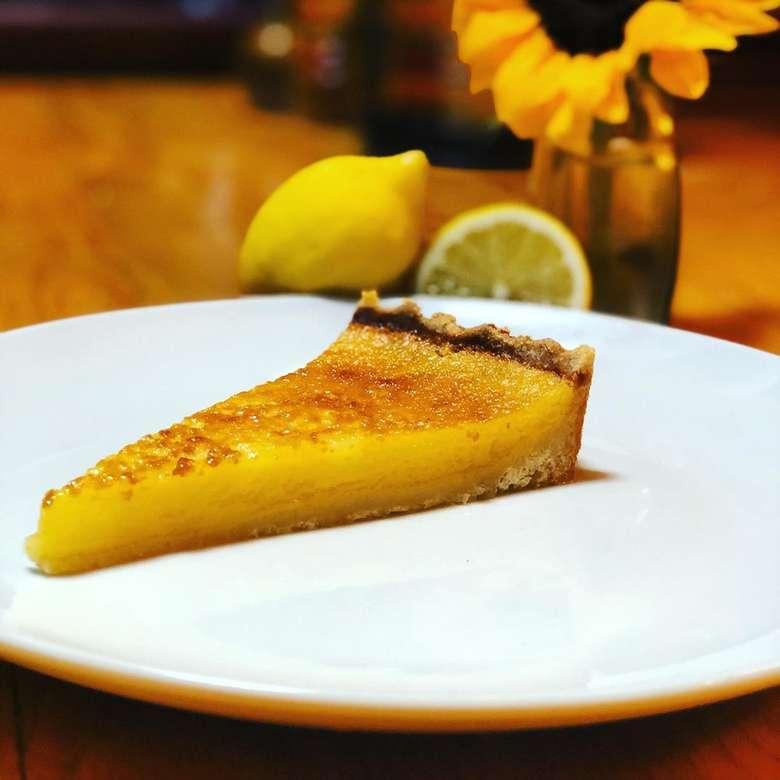 lemon tart on a white plate