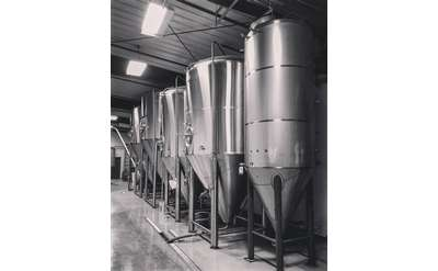 Brewery equipment lined up in a row