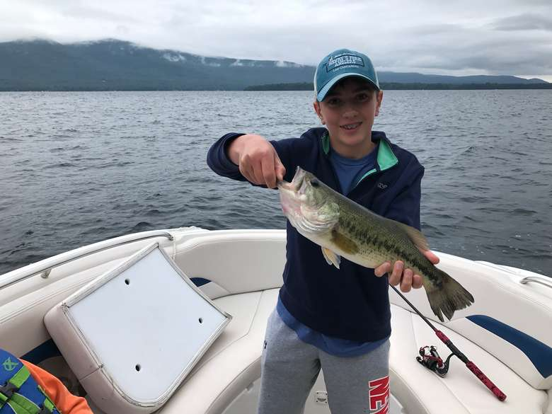 child holding a bass
