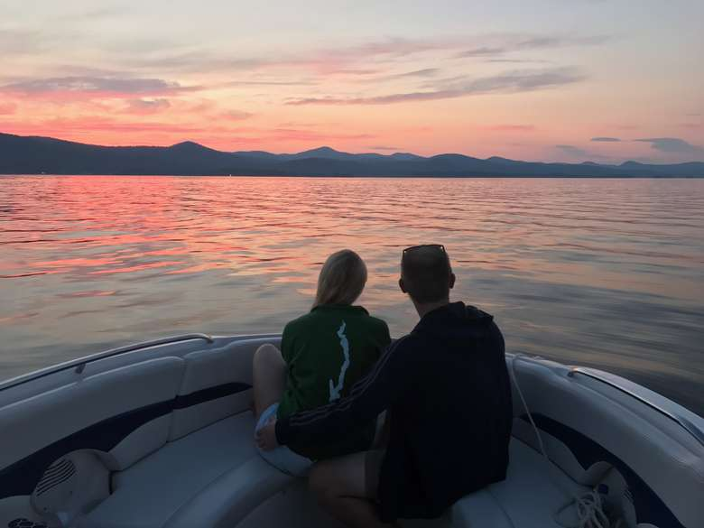 two people admiring the sunset from a boat