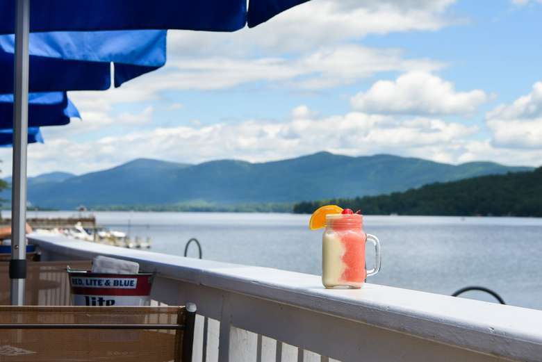 mason jar filled with a frozen drink on the patio overlooking lake george