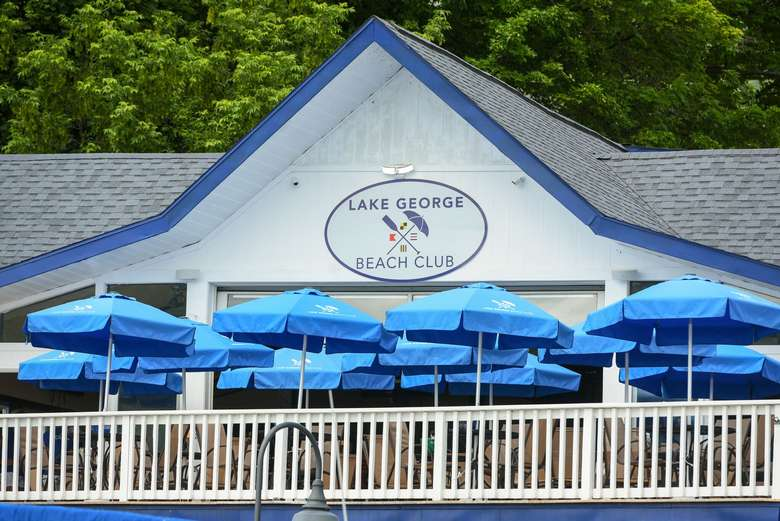 blue umbrellas on the patio at lake george beach club
