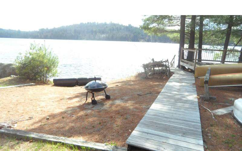 Head outside where there's a campfire area, a floating deck/raft, outdoor seating, and even an outdoor shower!