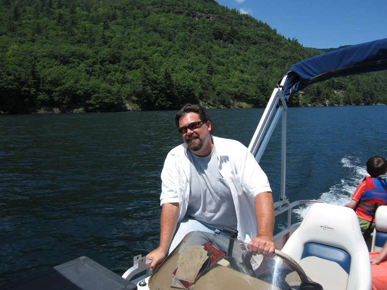 A man in a white shirt captaining a boat tour