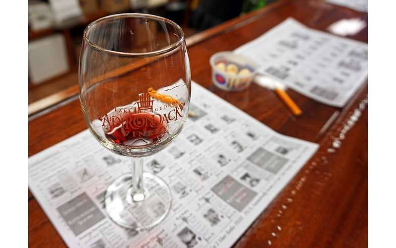 Souvenir wine tasting glass with a sheet describing all the available wines