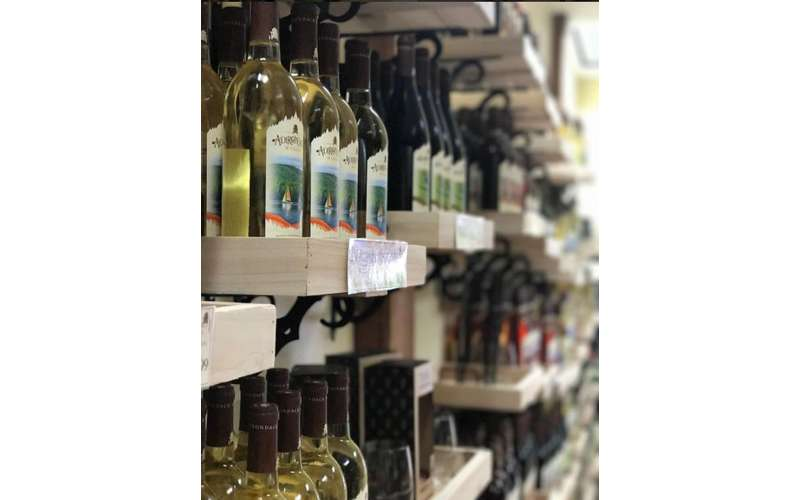 Close-up of racks filled with Adirondack Winery wines