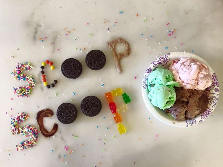 photo of ice cream with the words 'scoop scoop' written in ice cream toppings