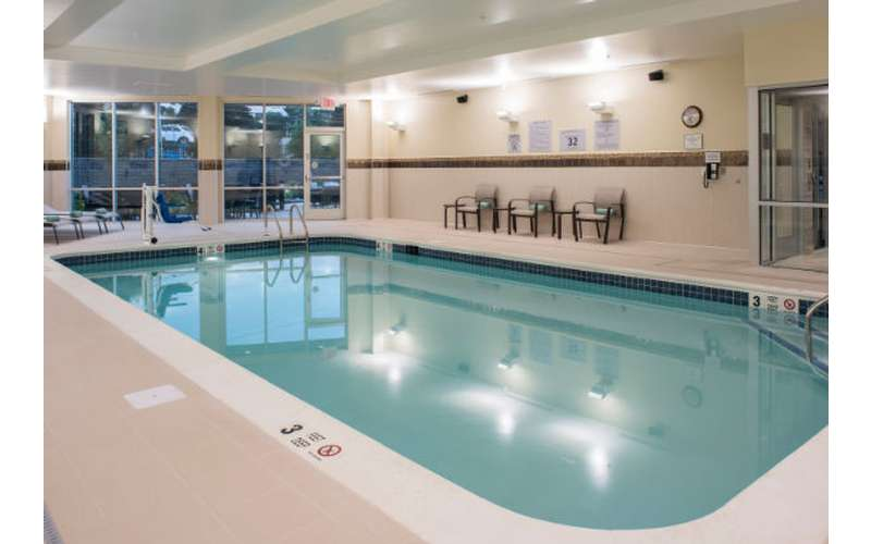 a large indoor pool that is clean and light blue in color
