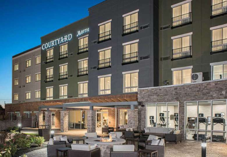 view of the outdoor patio at Courtyard Clifton Park by Marriott