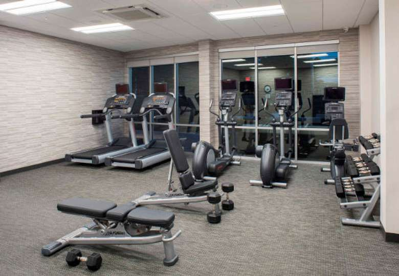 a fitness center with treadmills and workout machines