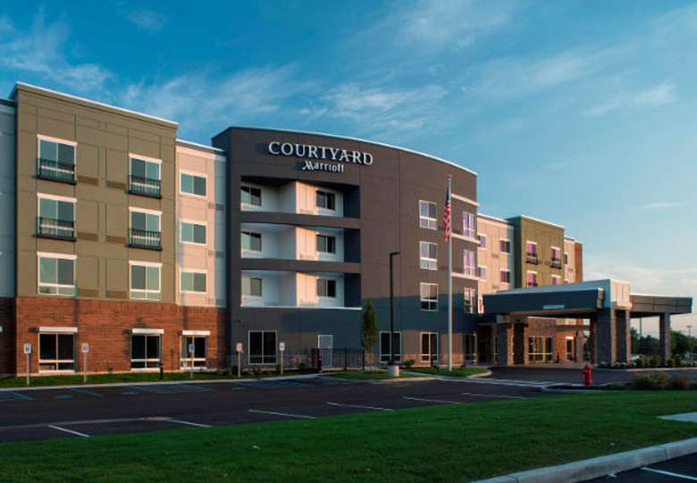 the front entrance of the Courtyard Clifton Park by Marriott